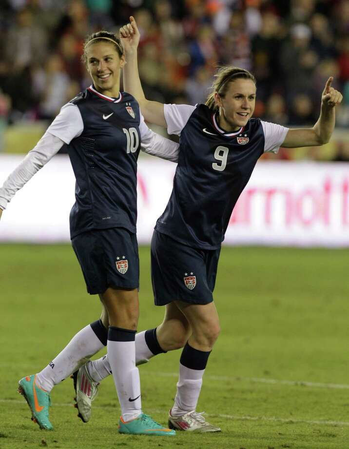 USA's Carli Lloyd, left, celebrates her goal against China with teammate Heather O'Reilly, right, during the second half of woman's soccer game at BBVA Compass Stadium Sunday, Jan. 9, 2000, in Houston. Photo: Melissa Phillip, Houston Chronicle / © 2012 Houston Chronicle