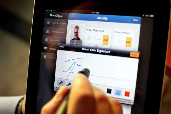 Tom Gonser, the founder of DocuSign, demon strates how to capture an electronic signature.