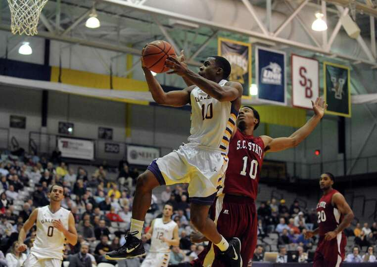 UAlbany's Mike Black goes in for a score during their game against S.C. State at the SEFCU Arena in