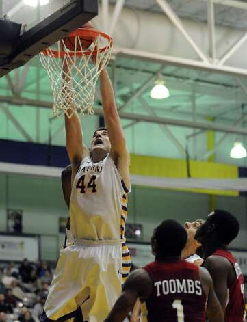 UAlbany's John Puk dunks for a score during their game against S.C. State at the SEFCU Arena in Albany , NY Wednesday Dec. 12, 2012. (Michael P. Farrell/Times Union) Photo: Michael P. Farrell