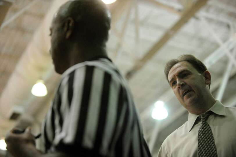 UAlbany's head coach Will Brown, right, talks with official Clarence Armstrong during their game aga