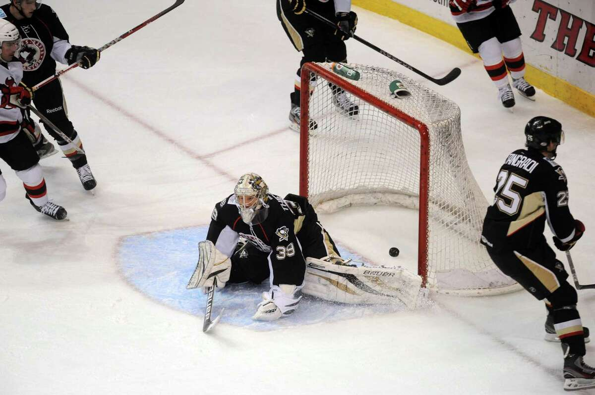 Wilkes-Barre/Scranton goalie Brad Thiessen lays in the crease after Albany Devils Bobby Butler scored a goal during their game at the Times Union Center in Albany , NY Wednesday Dec. 12, 2012. (Michael P. Farrell/Times Union)
