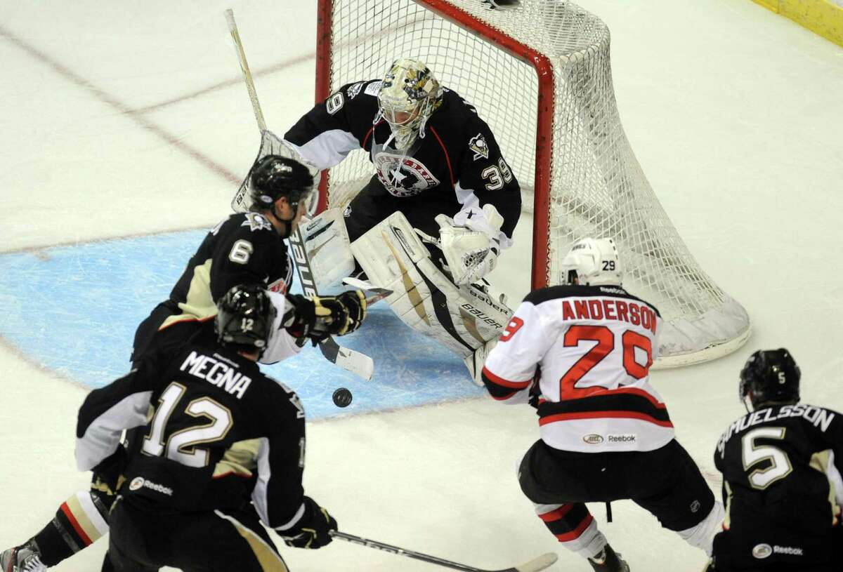 Wilkes-Barre/Scranton goalie Brad Thiessen makes a save during their game against the Devils at the Times Union Center in Albany , NY Wednesday Dec. 12, 2012. (Michael P. Farrell/Times Union)