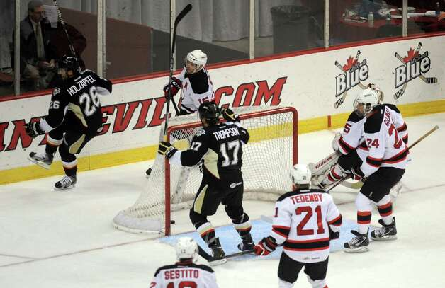 Wilkes-Barre/Scranton players celebrate after scoring a goal against the Albany Devils during their game at the Times Union Center in Albany , NY Wednesday Dec. 12, 2012. (Michael P. Farrell/Times Union) Photo: Michael P. Farrell