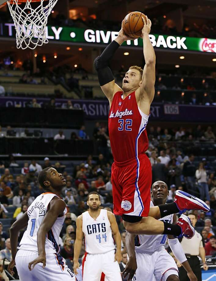 Blake Griffin launches a dunk as the Clippers won their eighth in a row, defeating the Bobcats. Photo: Chuck Burton, Associated Press