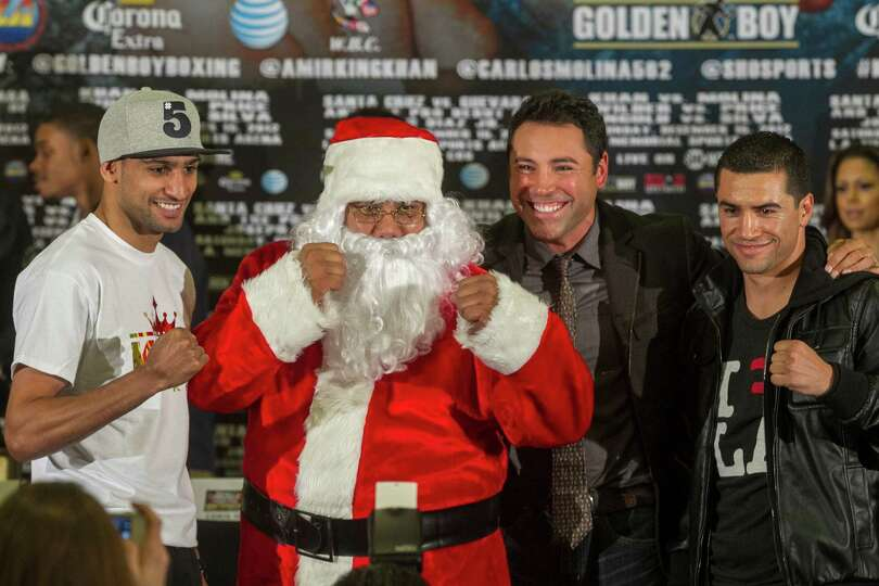 Golden Boy Promotions president Oscar De La Hoya second from right, and someone dressed as Santa Cla