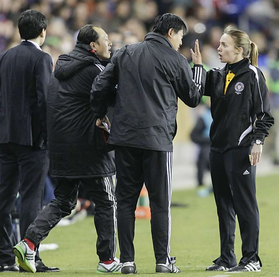 HOUSTON, TX - DECEMBER 12: China coaches have words with the fourth official in the second half at BBVA Compass Stadium on December 12, 2012 in Houston, Texas. USA won 4-0. (Photo by Bob Levey/Getty Images) Photo: Bob Levey, Getty Images