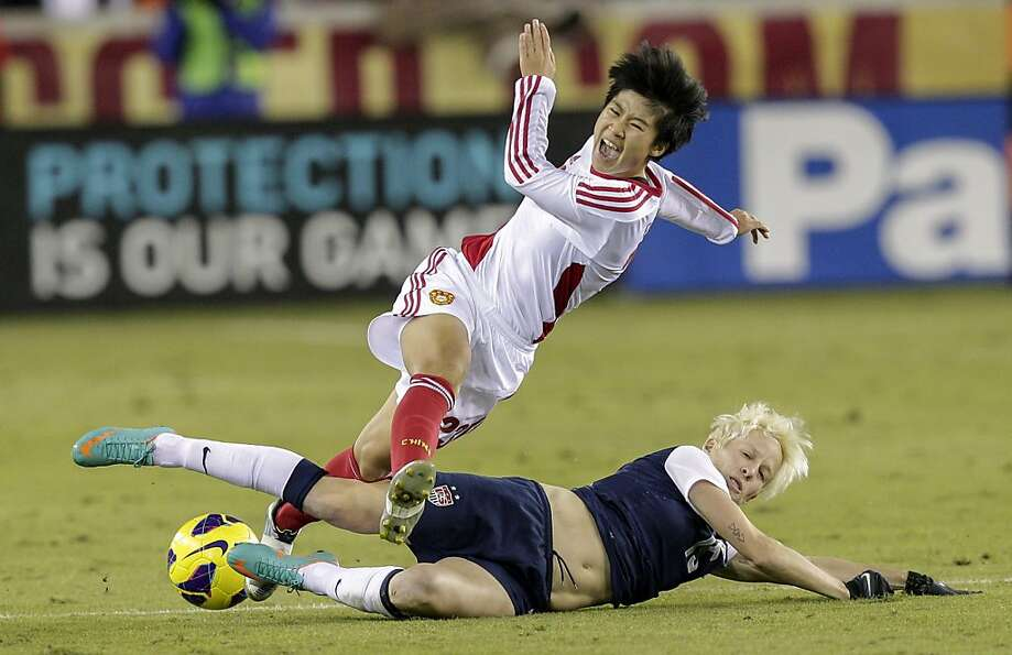 HOUSTON, TX - DECEMBER 12:  Ren Guixin #23 of China is upended by Megan Rapinoe #15 of the United St