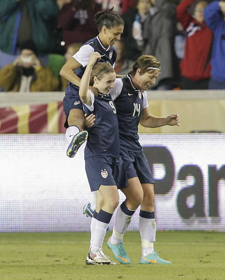 HOUSTON, TX - DECEMBER 12:  Abby Wambach #14 of the United States celebrates with Heather O'Reilly #9 and Shannon Boxx (7) in the second half at BBVA Compass Stadium on December 12, 2012 in Houston, Texas. USA won 4-0. (Photo by Bob Levey/Getty Images) Photo: Bob Levey, Getty Images