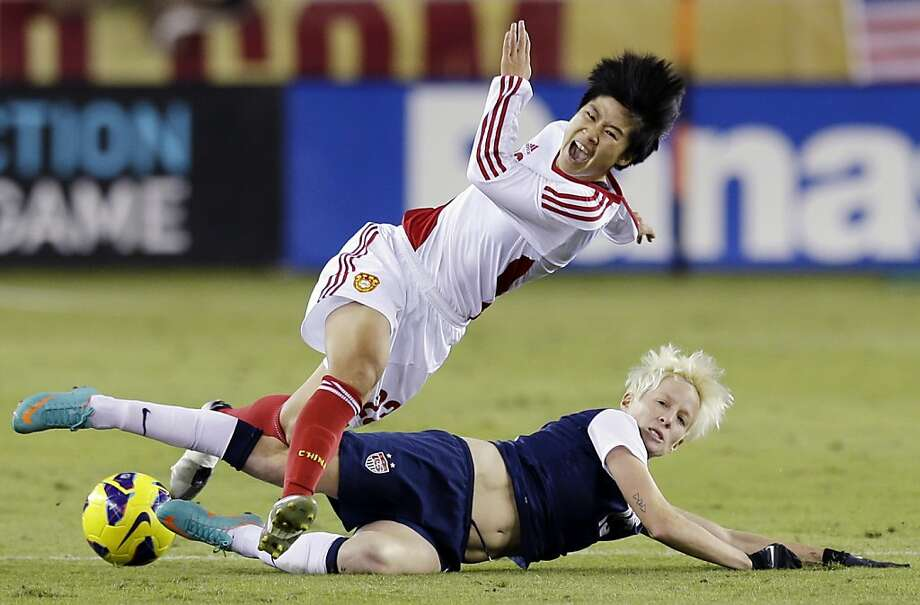 China's Ren Guixin and United States' Megan Rapinoe go after the ball during the second half of an exhibition soccer match, Wednesday, Dec. 12, 2012, in Houston. (AP Photo/David J. Phillip) Photo: David J. Phillip, Associated Press