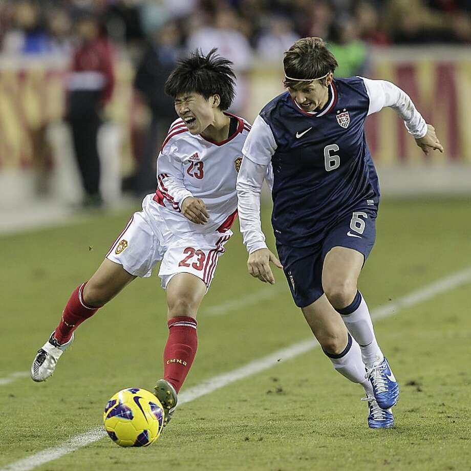 HOUSTON, TX - DECEMBER 12: Ren Guixin #23 of China takes a hard hit from Amy LePeilbet #6 of the United States in the second half at BBVA Compass Stadium on December 12, 2012 in Houston, Texas. USA won 4-0. (Photo by Bob Levey/Getty Images) Photo: Bob Levey, Getty Images