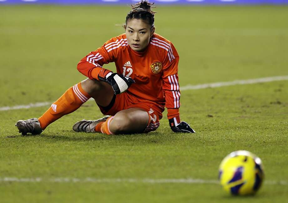 China goalie Wang Fei reacts after deflecting a shot during the first half of an exhibition soccer match against United States, Wednesday, Dec. 12, 2012, in Houston. (AP Photo/David J. Phillip) Photo: David J. Phillip, Associated Press