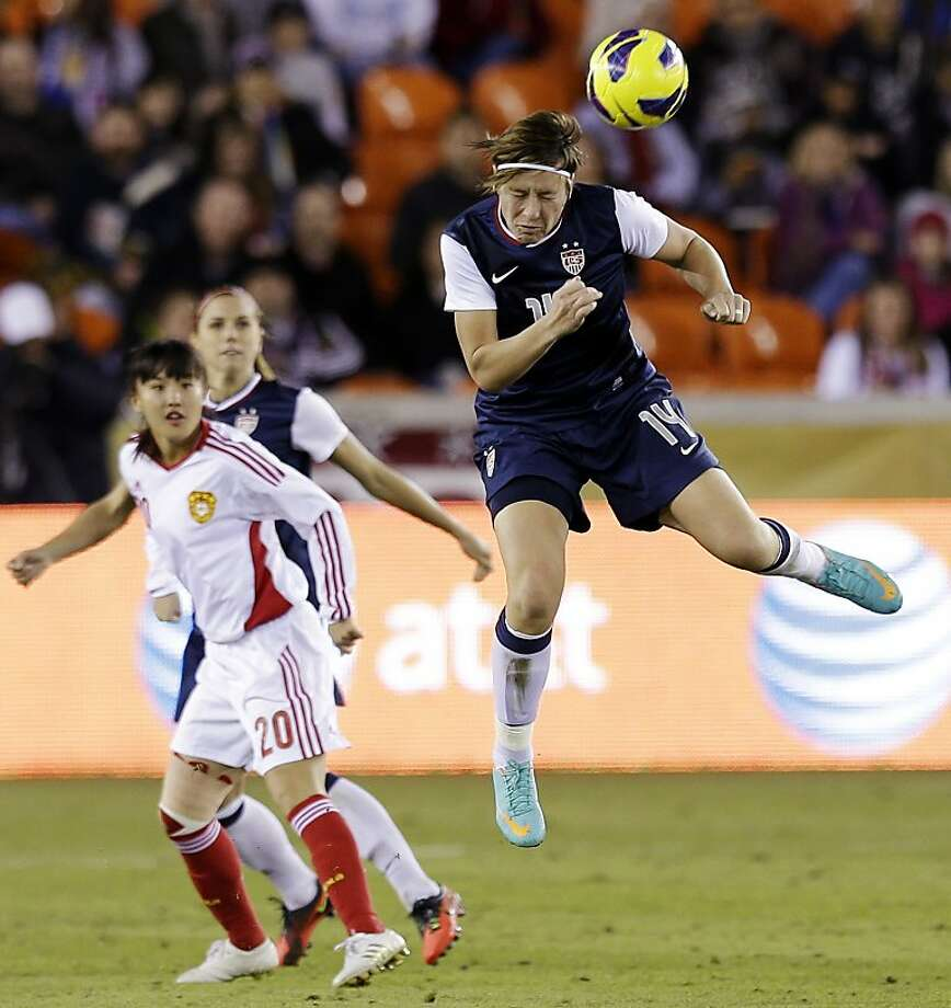 United States' Abby Wambach (14) heads a ball in front of China's Huang Yini during the second half of an exhibition soccer match, Wednesday, Dec. 12, 2012, in Houston. (AP Photo/David J. Phillip) Photo: David J. Phillip, Associated Press