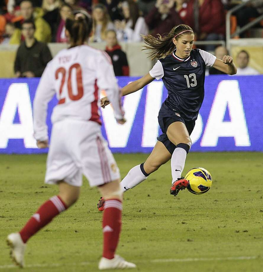 HOUSTON, TX - DECEMBER 12:  Alex Morgan #13 of the United States brings  the ball up the field against of China in the first half at BBVA Compass Stadium on December 12, 2012 in Houston, Texas. (Photo by Bob Levey/Getty Images) Photo: Bob Levey, Getty Images