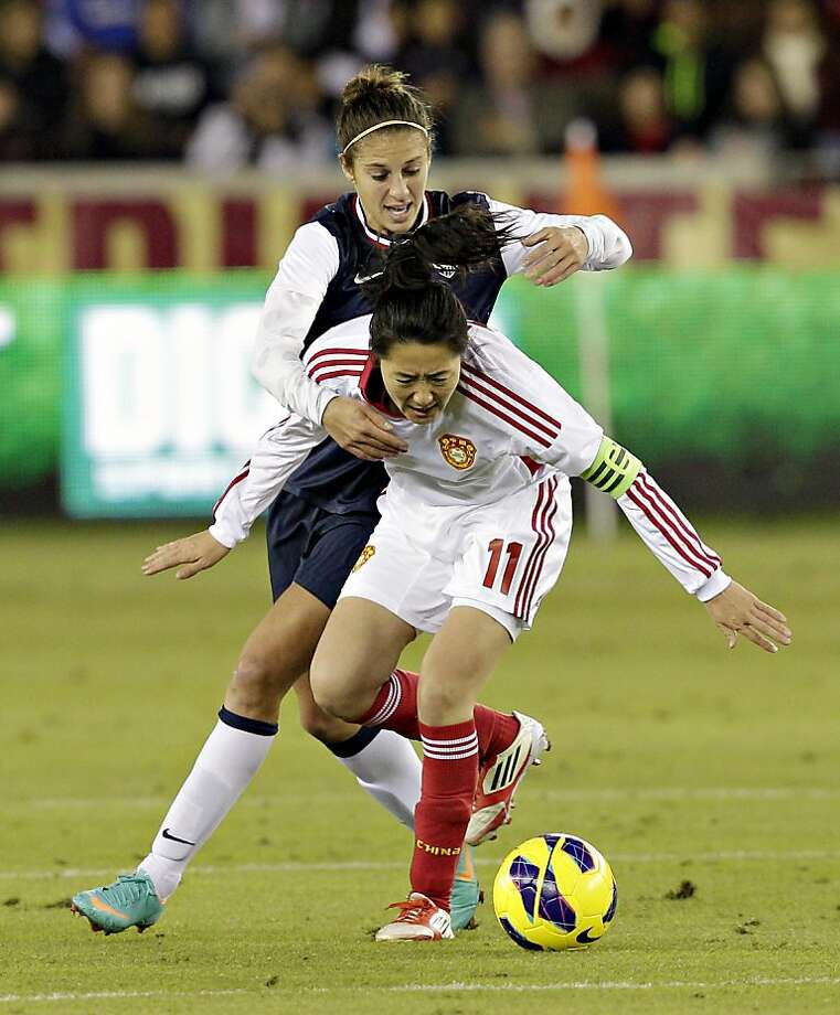 HOUSTON, TX - DECEMBER 12:  Pu Wei #11 of China and Carli Lloyd #10 of the United States battle for possession of the ball in the first half  at BBVA Compass Stadium on December 12, 2012 in Houston, Texas. (Photo by Bob Levey/Getty Images) Photo: Bob Levey, Getty Images