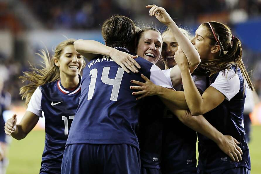 United States' Abby Wambach (14) celebrates with teammates after scoring a goal during the first hal