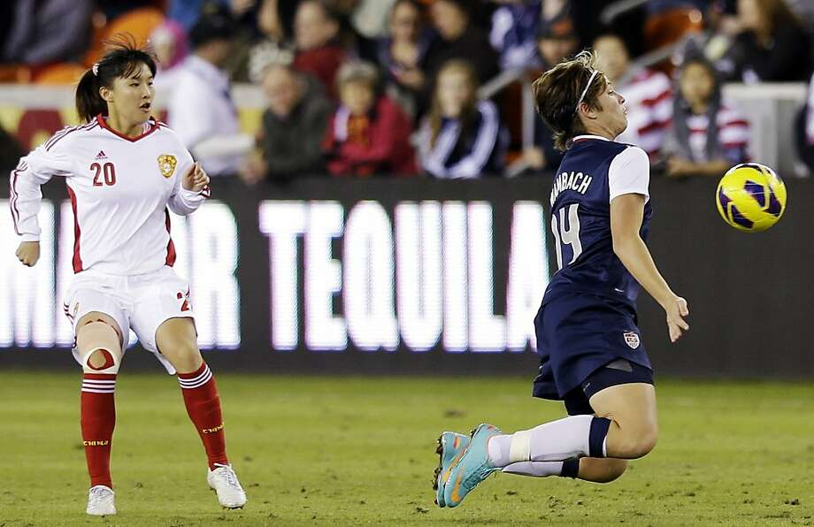 United States' Abby Wambach deflects a ball in front of China's Huang Yini during the second half of an exhibition soccer match, Wednesday, Dec. 12, 2012, in Houston. (AP Photo/David J. Phillip) Photo: David J. Phillip, Associated Press