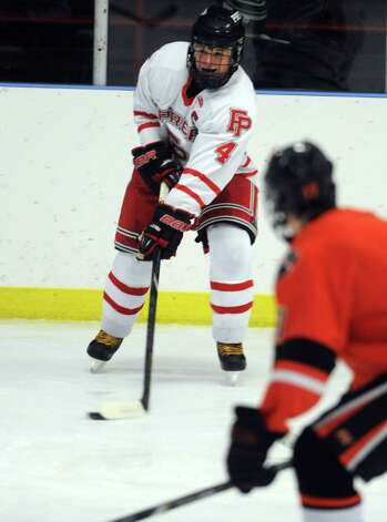 Fairfield Prep's Sean Henry controls the puck during their hockey game against Ridgefield High School Wednesday, Dec. 12, 2012 at Wonderland of Ice in Bridgeport, Conn. Photo: Autumn Driscoll / Connecticut Post