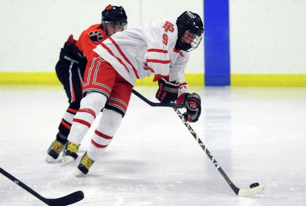 Fairfield Prep's Nick Bargiello controls the puck during their hockey game against Ridgefield High School Wednesday, Dec. 12, 2012 at Wonderland of Ice in Bridgeport, Conn. Photo: Autumn Driscoll / Connecticut Post