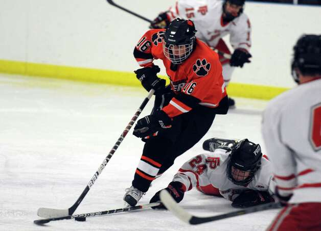 Ridgefield's Brendan Winne controls the puck as Fairfield Prep's Brendan Killoy defends during their hockey game Wednesday, Dec. 12, 2012 at Wonderland of Ice in Bridgeport, Conn. Photo: Autumn Driscoll / Connecticut Post