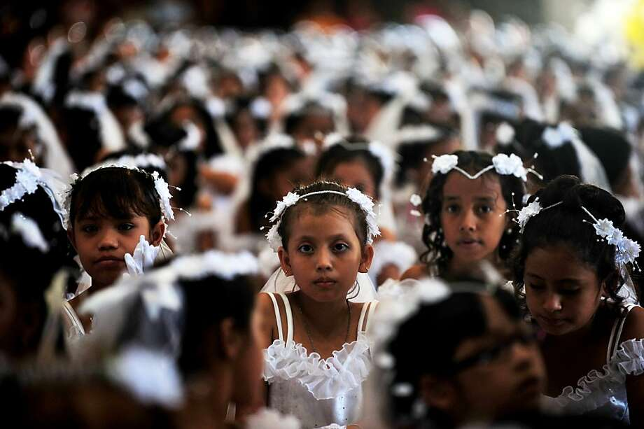 Children attend a mass in which about 550 children had their first communion at the metropolitan cathedral in Managua, on December 12, 2012. AFP PHOTO/Hector RETAMALHECTOR RETAMAL/AFP/Getty Images Photo: Hector Retamal, AFP/Getty Images