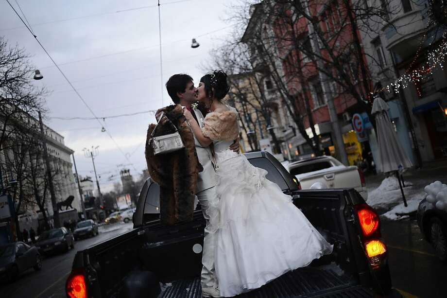 "A Bulgarian couple kiss on the back of a pick-up truck before their wedding ceremony in Sofia on December 12, 2012. More than a hundred couples in Bulgaria chose to mark the once in a lifetime date 12/12/12 by saying ""I do"" on the special day.       TOPSHOTS/AFP PHOTO / DIMITAR DILKOFFDIMITAR DILKOFF/AFP/Getty Images Photo: Dimitar Dilkoff, AFP/Getty Images"