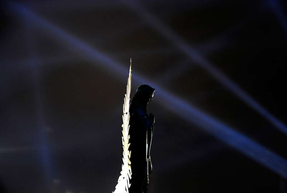 Lights are shone over an image of the Guadalupe Virgin at the Basilica de Guadalupe in Mexico City on December 11, 2012.  Mexicans celebrated the appearance of the Virgin of Guadalupe to Juan Diego in 1531.    AFP PHOTO/Alfredo EstrellaALFREDO ESTRELLA/AFP/Getty Images Photo: Alfredo Estrella, AFP/Getty Images