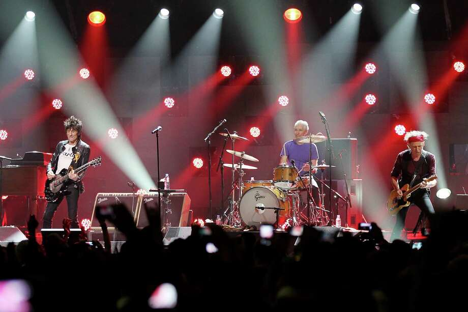 This image released by Starpix shows Ron Wood, from left, Charlie Watts, and Keith Richards of The Rolling Stones performing at the 12-12-12 The Concert for Sandy Relief at Madison Square Garden in New York on Wednesday, Dec. 12, 2012. Proceeds from the show will be distributed through the Robin Hood Foundation. (AP Photo/Starpix, Dave Allocca) Photo: Dave Allocca, Associated Press / Associated Press