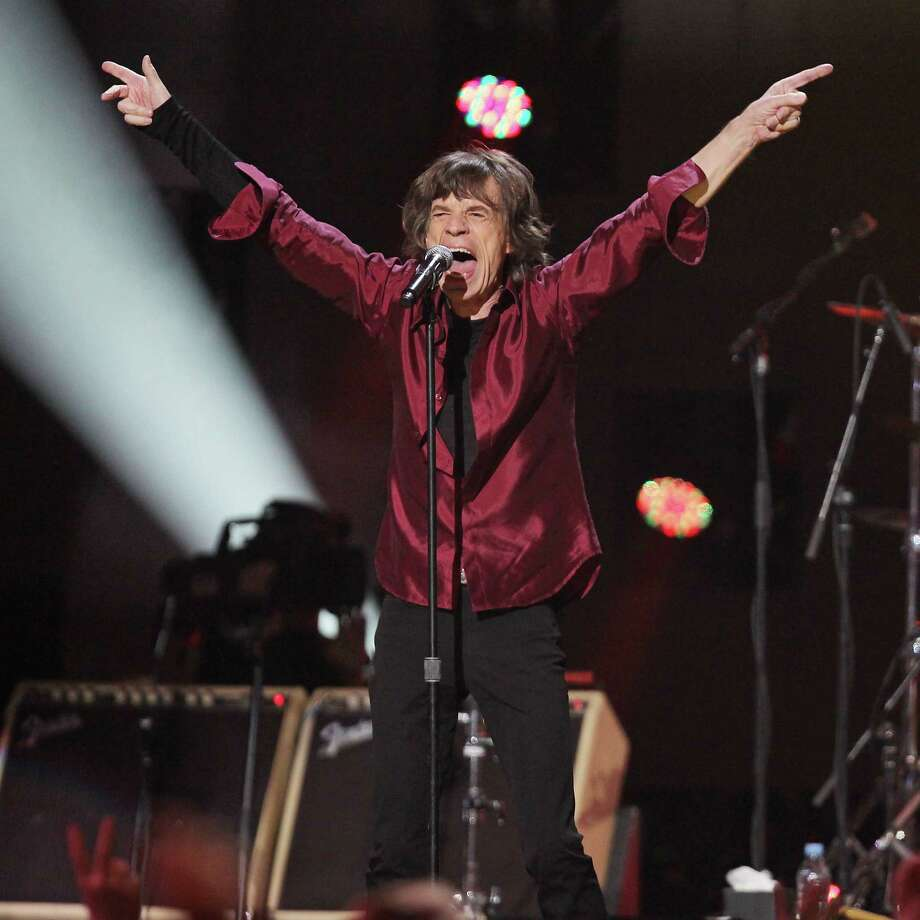 This image released by Starpix shows Mick Jagger of The Rolling Stones performing at the 12-12-12 The Concert for Sandy Relief at Madison Square Garden in New York on Wednesday, Dec. 12, 2012. Proceeds from the show will be distributed through the Robin Hood Foundation. (AP Photo/Starpix, Dave Allocca) Photo: Dave Allocca, Associated Press / Associated Press