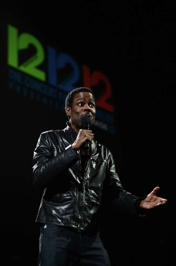 "NEW YORK, NY - DECEMBER 12:  Actor Chris Rock speaks onstage at ""12-12-12"" a concert benefiting The Robin Hood Relief Fund to aid the victims of Hurricane Sandy presented by Clear Channel Media & Entertainment, The Madison Square Garden Company and The Weinstein Company at Madison Square Garden on December 12, 2012 in New York City.  (Photo by Larry Busacca/Getty Images for Clear Channel) Photo: Larry Busacca, Getty Images / Getty Images"