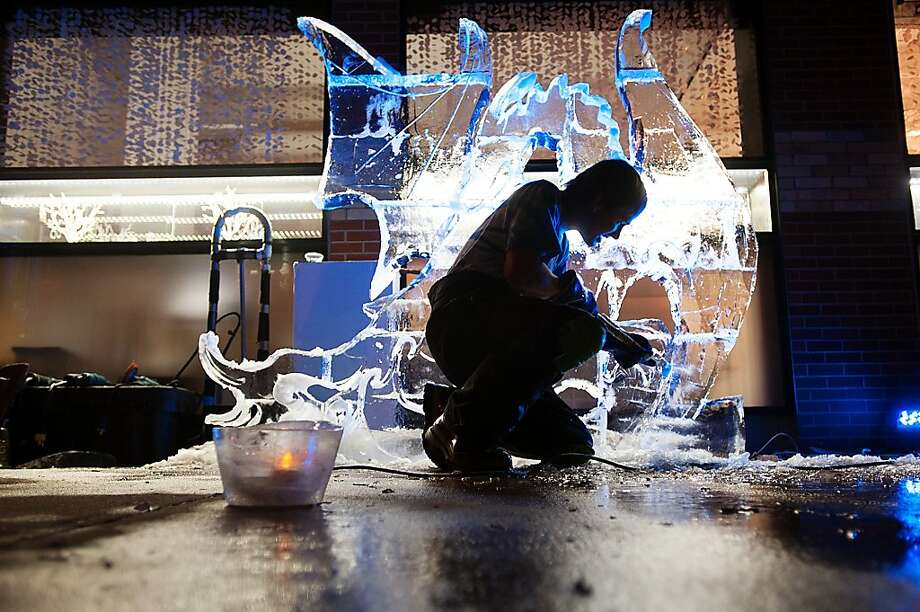 In this Dec. 1, 2012 photo, Jess Parrish works on an ice sculpture of a dragon outside Todd Reed Jewelry Store in Boulder, Colo.  Parrish began Cool Hand Ice Carving about six years ago and also competes in national ice carving competitions.  (AP Photo/The Daily Camera, Kira Horvath) NO SALES; TV OUT; MAGS OUT Photo: Kira Horvath, Associated Press