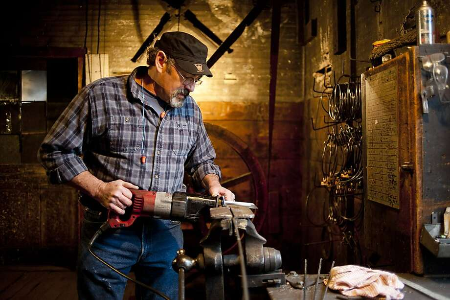 Coppersmith Steve Shiffer uses an electric saw to cut sections of rod steel to bend and creating the rim of the kettles at the D Picking & Co. facility in Bucyrus, Ohio, U.S., on Tuesday, Dec. 11, 2012. Copper rose on bets that moves by the Federal Reserve to expand economic stimulus will weaken the dollar and boost demand in the U.S., the world's second-largest user of the metal. Photographer: Ty Wright/Bloomberg *** Local Caption *** Steve Shiffer Photo: Ty Wright, Bloomberg