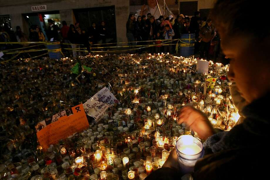 Fans of Mexican-US singer Jenni Rivera walk during a procession to the Basilica of Guadalupe in Monterrey, Nuevo Leon state, Mexico on December 11, 2012. The wreckage of a plane carrying Rivera was found in northern Mexico and there were no survivors, officials said. The Lear Jet was flying from Monterrey to Toluca, and was carrying six other people besides the singer, said Iturbide's Mayor Antonio Gonzalez. AFP PHOTO/JULIO CESAR AGUILARJulio Cesar Aguilar/AFP/Getty Images Photo: Julio Cesar Aguilar, AFP/Getty Images