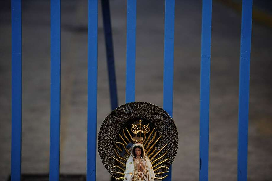 View of an image of the Guadalupe Virgin near the Basilica de Guadalupe in Mexico City on December 12, 2012. Mexicans celebrated the appearance of the Virgin of Guadalupe to Juan Diego in 1531. AFP PHOTO/Alfredo EstrellaALFREDO ESTRELLA/AFP/Getty Images Photo: Alfredo Estrella, AFP/Getty Images