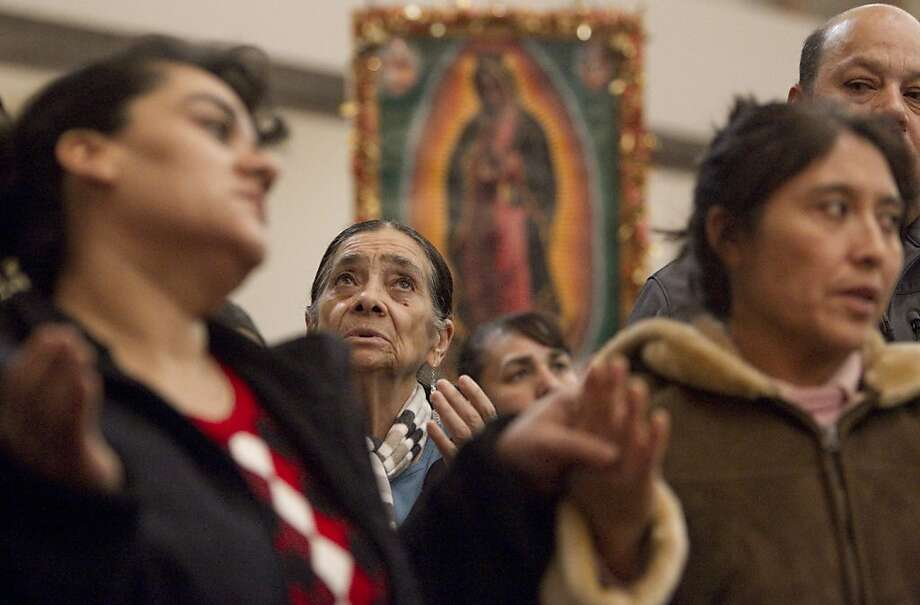 Worshippers at St. Joseph Catholic Church in Yakima, Wash. celebrate the Virgin of Guadalupe in a pre-dawn service Wednesday  Dec. 12, 2012.  The Virgin of Guadalupe is considered the patron saint of Mexico. (AP Photo/Yakima Herald-Republic, Gordon King) Photo: Gordon King, Associated Press
