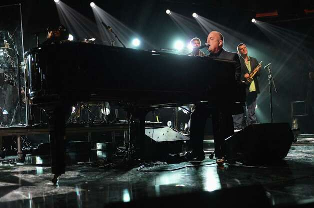"NEW YORK, NY - DECEMBER 12:  Billy Joel performs at ""12-12-12"" a concert benefiting The Robin Hood Relief Fund to aid the victims of Hurricane Sandy presented by Clear Channel Media & Entertainment, The Madison Square Garden Company and The Weinstein Company at Madison Square Garden on December 12, 2012 in New York City.  (Photo by Larry Busacca/Getty Images for Clear Channel) Photo: Larry Busacca, Getty Images / Getty Images"