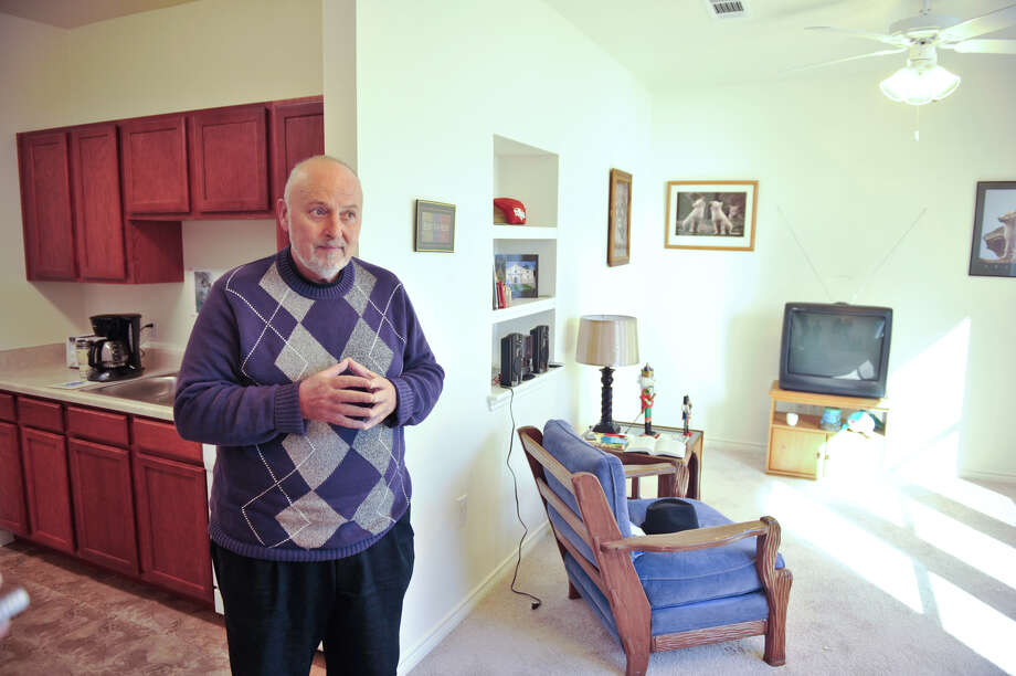 Beaux Gilliam, who was the first resident of The Terraces, an affordable living apartment complex that is part of Haven for Hope, looks over hjis one-bedroom apartment, Photo: Robin Jerstad/For The Express-Ne