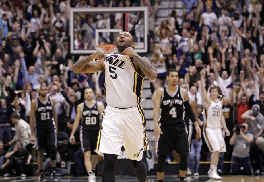 Utah Jazz point guard Mo Williams (5) celebrates after scoring the game winning shoot an the end of their NBA basketball game against the San Antonio Spurs Wednesday, Dec.12, 2012, in Salt Lake City. The Jazz defeated the Spurs 99-96. (Rick Bowmer / Associated Press)