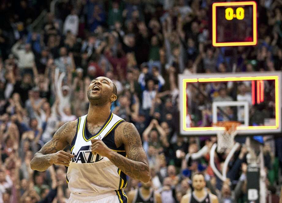 Utah Jazz point guard Mo Williams (5) celebrates after scoring the game-winning shot in their NBA basketball game against the San Antonio Spurs Wednesday, Dec. 12, 2012, in Salt Lake City. The Jazz defeated the Spurs 99-96. (Ben Brewer / The Deseret News)