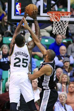 Utah Jazz center Al Jefferson (25) shoots as San Antonio Spurs forward Tim Duncan, right, defends in the second quarter during an NBA basketball game, Wednesday, Dec. 12, 2012, in Salt Lake City. (Rick Bowmer / Associated Press)