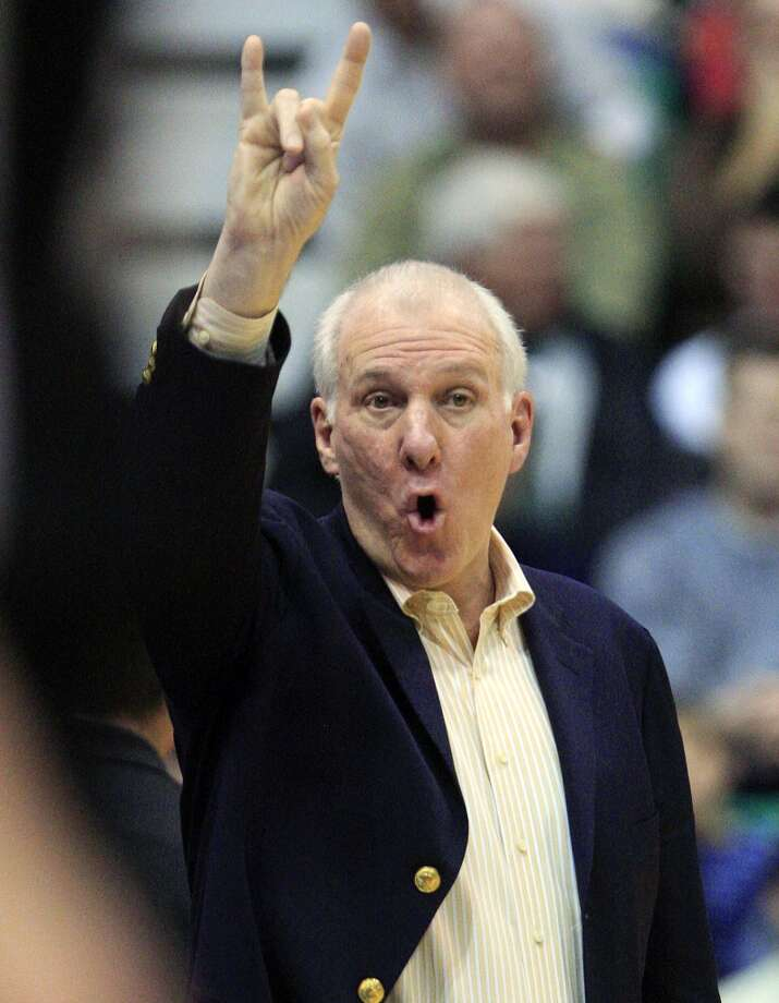 San Antonio Spurs head coach Gregg Popovich shouts to his team in the second quarter during an NBA basketball game against the Utah Jazz, Wednesday, Dec. 12, 2012, in Salt Lake City.  (Rick Bowmer / Associated Press)