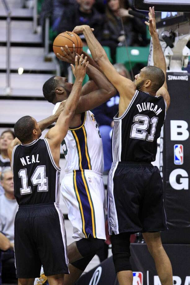 San Antonio Spurs forward Tim Duncan (21) and guard Gary Neal (14) defend against Utah Jazz center Al Jefferson (25) in the first quarter during an NBA basketball game, Wednesday, Dec. 12, 2012, in Salt Lake City. (Rick Bowmer / Associated Press)