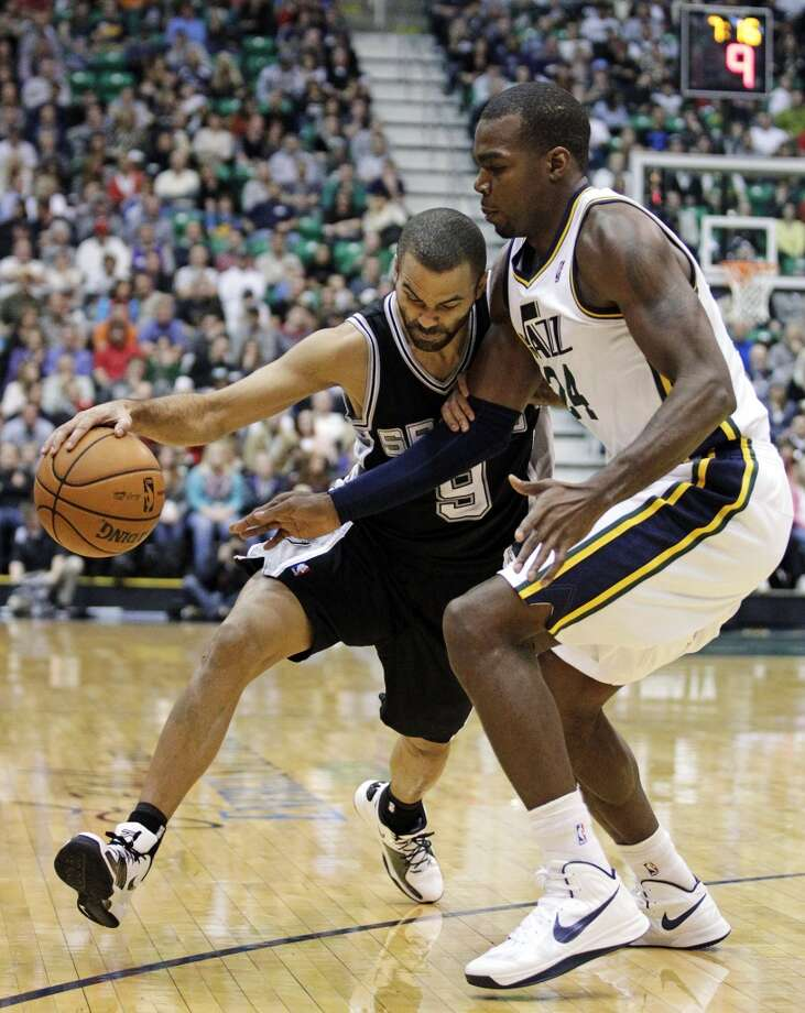 Utah Jazz forward Paul Millsap (24) defends against San Antonio Spurs point guard Tony Parker (9) in the second quarter during an NBA basketball game, Wednesday, Dec. 12, 2012, in Salt Lake City.  (Rick Bowmer / Associated Press)