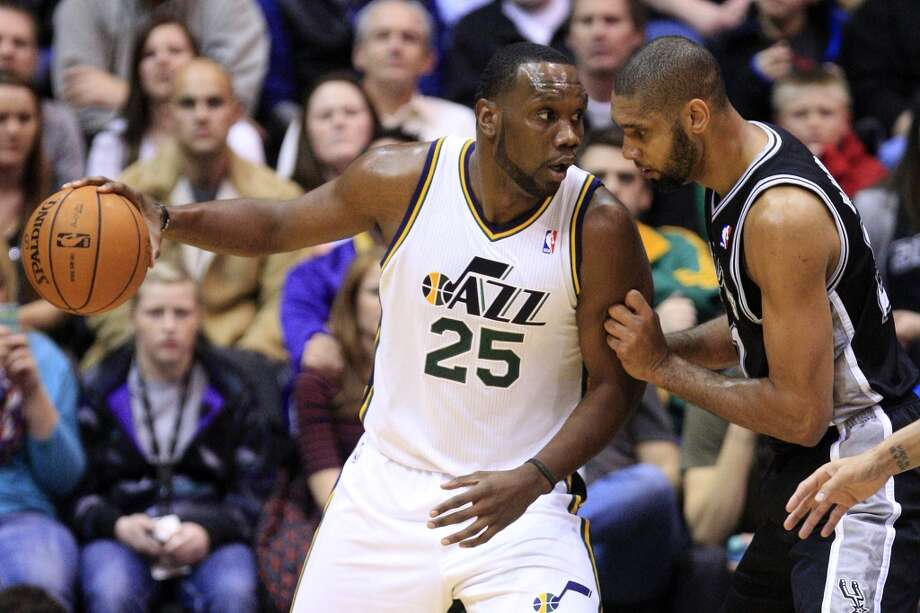 San Antonio Spurs forward Tim Duncan, right, defends against Utah Jazz center Al Jefferson (25) in the first quarter during an NBA basketball game, Wednesday, Dec. 12, 2012, in Salt Lake City. (Rick Bowmer / Associated Press)
