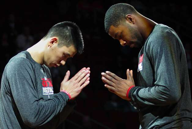 Rockets guard Jeremy Lin greets Rockets forward Marcus Morris during introductions before the start of the Rockets matchup with the Wizards.  (Billy Smith II / Houston Chronicle)