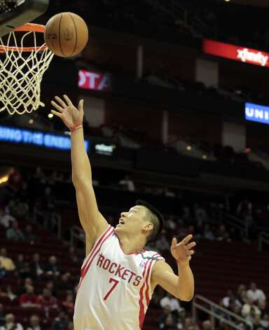 Dec. 12: Rockets 99, Wizards 93Rockets guard Jeremy Lin puts up a shot in the first half.  (Billy Smith II / Houston Chronicle)