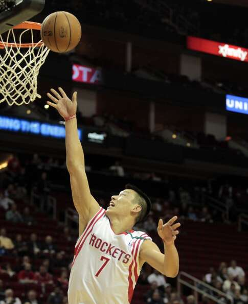 Dec. 12: Rockets 99, Wizards 93Rockets guard Jeremy Lin puts up a shot in the fi