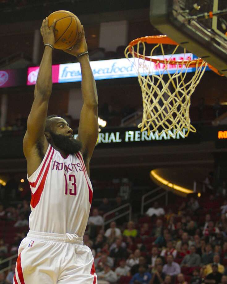 James Harden gets an open dunk on a fast break. (Billy Smith II / Houston Chronicle)