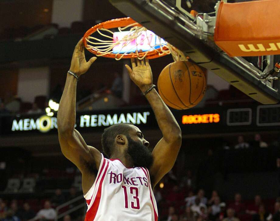Rockets guard James Harden gets an open dunk. (Billy Smith II / Houston Chronicle)