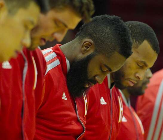 Rockets guard James Harden bows his head during the National Anthem. (Billy Smith II / Houston Chronicle)